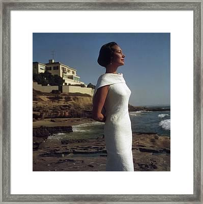 Elegance On The Beach Framed Print by Slim Aarons
