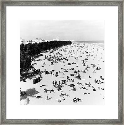 Enjoying Miami Beach Framed Print by Fpg