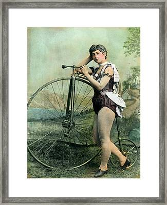 Female Circus Performer With Bicycle Framed Print by Bettmann