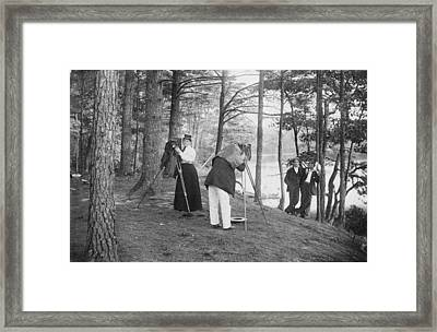 Female Photographer Adusts Her Camera Framed Print by Hulton Archive