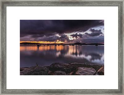 First Light With Heavy Rain Clouds On The Bay Framed Print