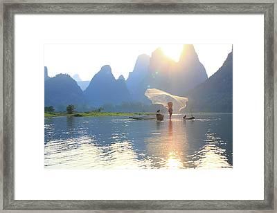 Fishing On The Li River Framed Print by Bihaibo