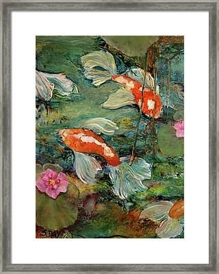 Fishy Tales Framed Print