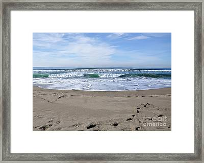 Footprints By The Sea Framed Print