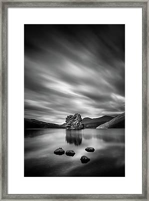 Four Rocks Framed Print