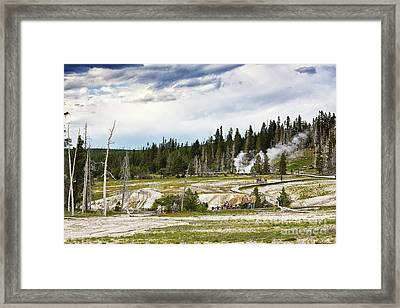 Framed Print featuring the photograph Fuming Geysers In Yellowstone National Park by Tatiana Travelways