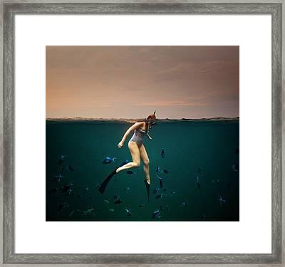 Girl Snorkelling Framed Print