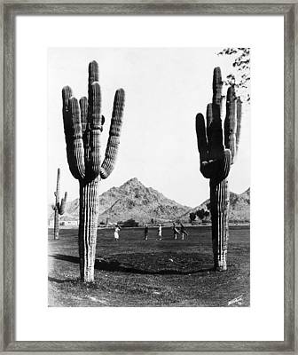 Golf In The Desert Framed Print by General Photographic Agency