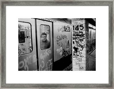 Graffiti Covers Platform And Subway At Framed Print