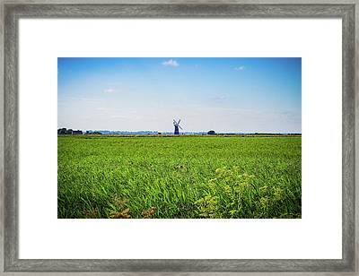 Framed Print featuring the photograph Green Grass Field With Windmill On Horizon by Scott Lyons