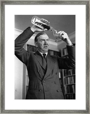 Greene Pours Drink Framed Print by Kurt Hutton
