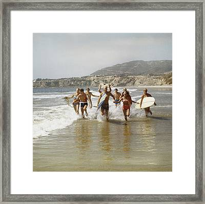 Group Of Surfers Running In Water With Framed Print