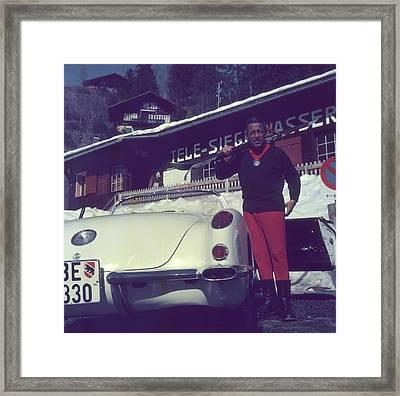 Gstaad Skier Framed Print by Slim Aarons