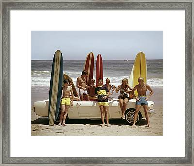 Guys And Gals On The Beach Framed Print
