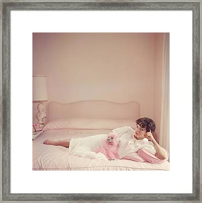 Joan Collins Relaxes Framed Print by Slim Aarons