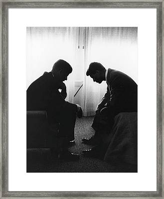 John Kennedy Confers With Robert Kennedy Framed Print