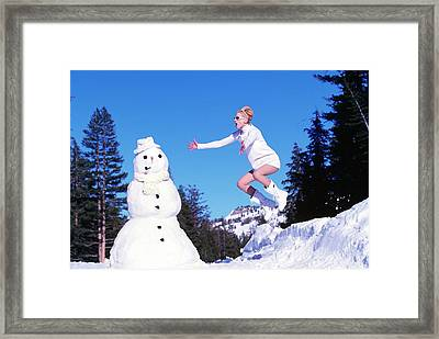 Kristen Mcmenamy In Dolce And Gabbana With Snowman Framed Print by Arthur Elgort