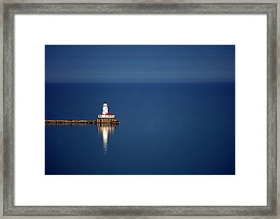 Lighthouse On A Lake Framed Print by By Ken Ilio