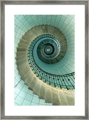 Looking Up The Spiral Staircase Of The Framed Print