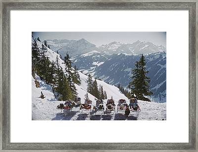 Lounging In Gstaad Framed Print by Slim Aarons