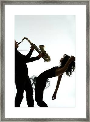 Man Playing Saxophone, With Young Woman Framed Print
