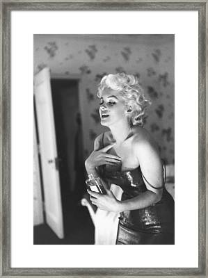 Marilyn Monroe With Chanel No. 5 Framed Print