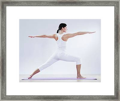 Mid Adult Woman Doing Yoga Against Framed Print by Westend61