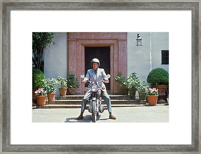 Mitchell On Motorcycle Framed Print by Slim Aarons