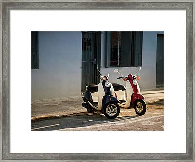 Motorbikes Parked On The Road Framed Print