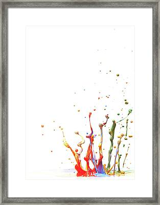 Multicolor Paint Splash Against A White Framed Print by Banksphotos