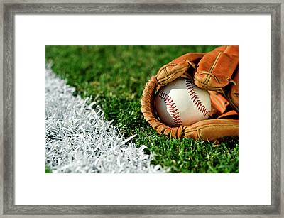 New Baseball In Glove Along Foul Line Framed Print by Cmannphoto