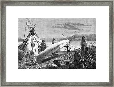 Ojibwe Repairing A Canoe Framed Print by Hulton Archive