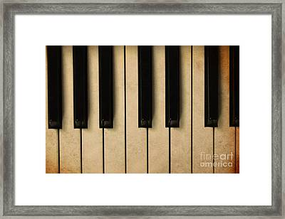 Old Piano Vintage Background Framed Print by Midiwaves