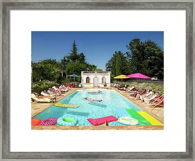 People Enjoying Summer Around The Pool Framed Print
