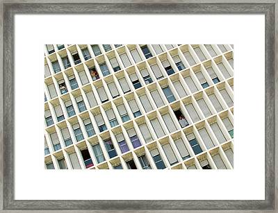 People Looking Through Windows Framed Print by Xavier Zimbardo