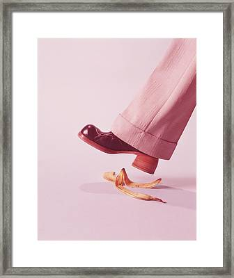 Person About To Step On Banana Skin Framed Print by H. Armstrong Roberts