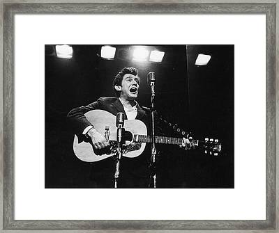 Phil Ochs Performs On Stage Framed Print by Fred W. McDarrah