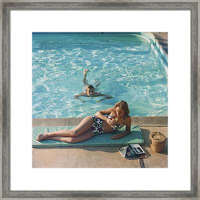 Poolside On Shelter Island Framed Print by Slim Aarons