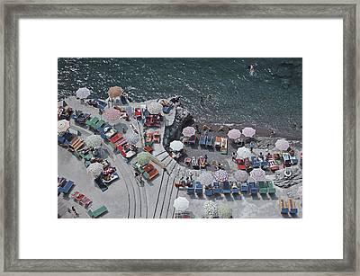 Positano Beach Framed Print by Slim Aarons