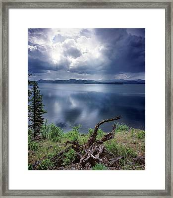 Priest Lake Light Framed Print by Leland D Howard