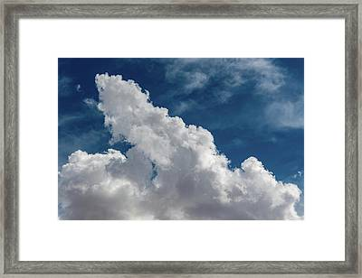 Puffy White Clouds Framed Print