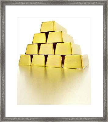 Pyramid Of Gold Bars Framed Print by John Kuczala