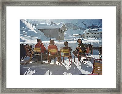 Relaxing In Lech Framed Print by Slim Aarons
