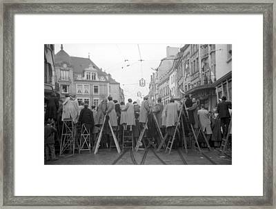 Resourceful Crowd Framed Print by Kurt Hutton