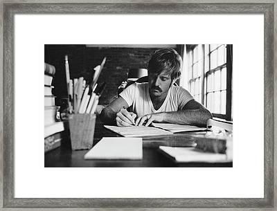 Robert Redford Writing At Desk Framed Print by John Dominis
