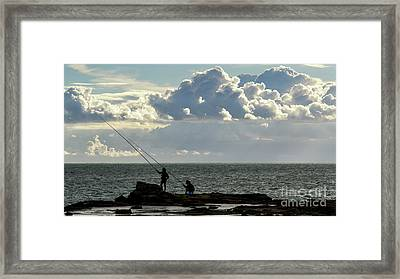 Framed Print featuring the photograph Rock Fishing by Pablo Avanzini