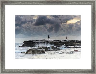 Rock Ledge, Spear Fishermen And Cloudy Seascape Framed Print