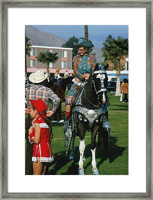 Rodeo Finery Framed Print by Slim Aarons