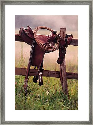 Saddle And Lasso On Fence Framed Print by Comstock