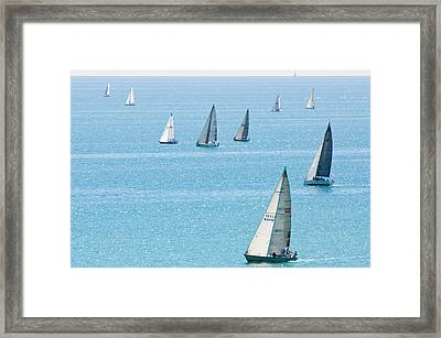 Sailboats Racing On Blue Water Framed Print by By Ken Ilio